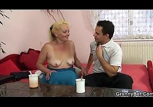 Elderly flaxen-haired grandma enjoys riding cock