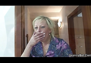 Grey granny is group-fucked away from an juvenile gay blade