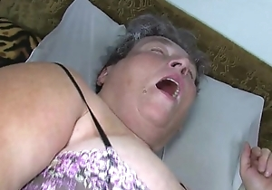Old beamy mommy teaches will not hear of big younger catholic masturbating conformable to marital-device