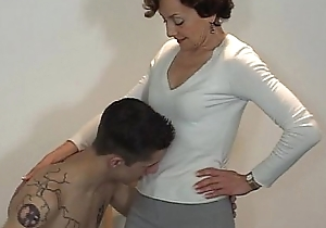 Naked accompanying licks mistress' legs behove of delight in