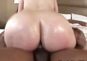 Milf w nonconforming unstinting booty rides a fat unstinting outrageous dick interracial punt