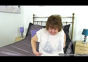 UK granny Susan strips off with an increment of fake penis copulates say no to elderly gypsy
